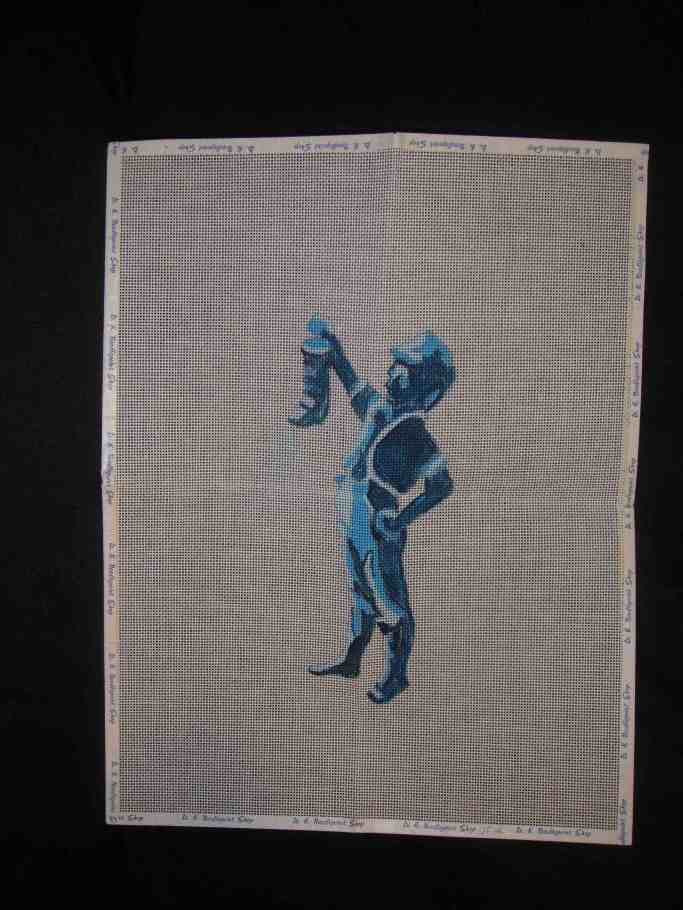 boy with boot needlepoint